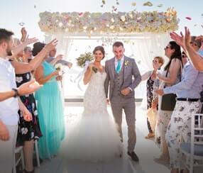 People walking down aisle at wedding